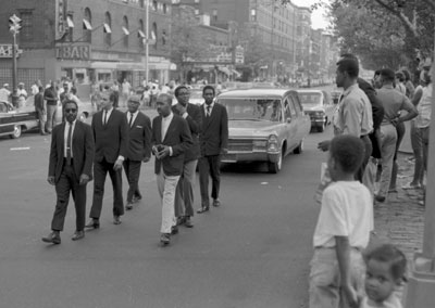Bud Powell's pallbearers: on right, back to front, Kenny Dorham, Willie Jones, unknown; on left, unknown, Tony Scott, unknown.