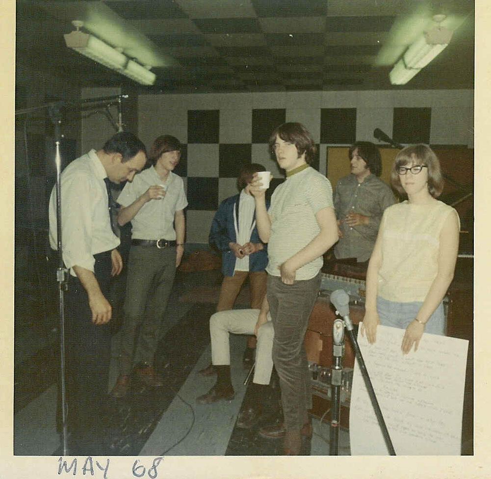 In the studio with Dick Wagner, second from right in back. Janet holds lyrics to one of the songs.
