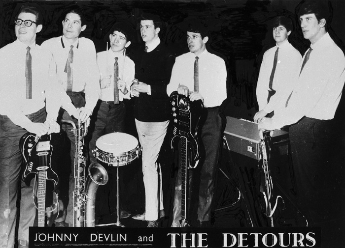 Johnny Devlin & the Detours, 1962 or 1963, from left: Arthur Biggs, Bob Pettit, Bernie Smith, Johnny Devlin, Bryan Stevens, Mick Ketley, and Chuck Fryers