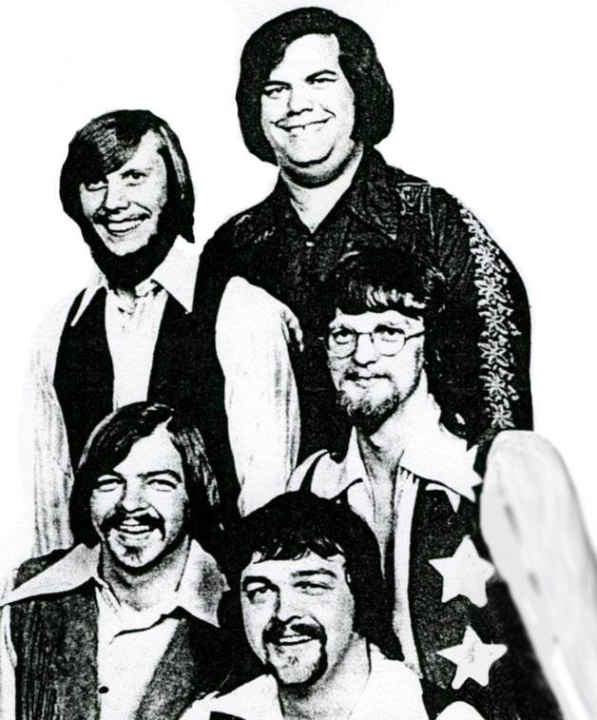 "O'Kaysions (third generation, ca. 1970-71) Top row, L-R: Gary ""Groove"" Pugh (drums/vocals); Big Jim Lowry (guitar/vocals). Second row: Donny Trexler (guitar/vocals); Allen Brewer (bass/vocals). Front and center: Lenny Collins (drums)"